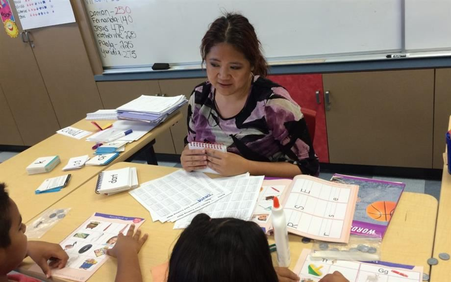 Above, specialized instruction taught one-to-one or in small groups helps students with dyslexia to