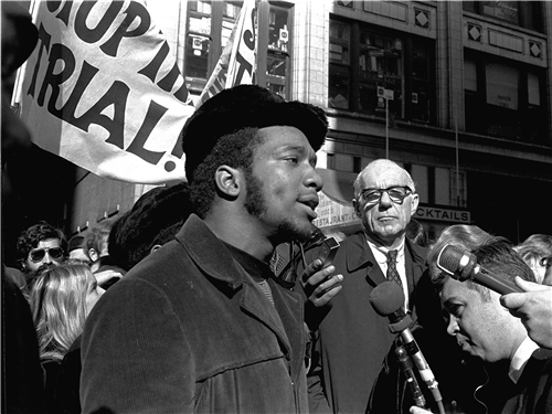 Black and White picture of Fred Hampton at a rally