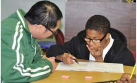 Teacher and student working on a lesson
