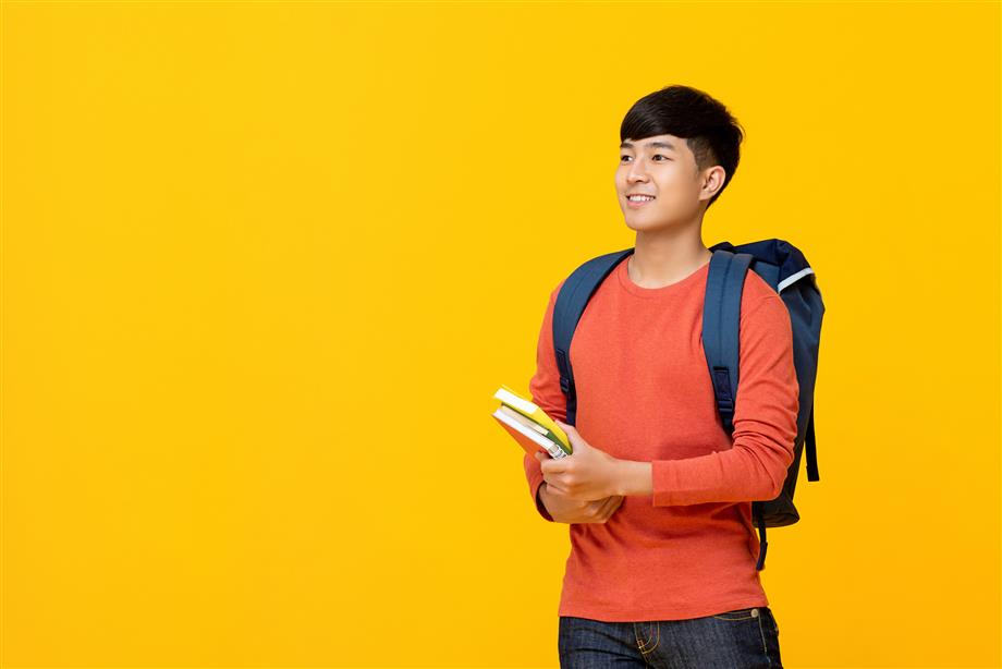 High school student holding books