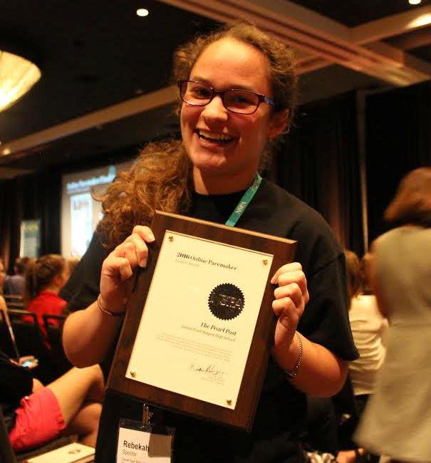 Rebekah Spector, Editor in Chief, posing with the Pacemaker Finalist Award