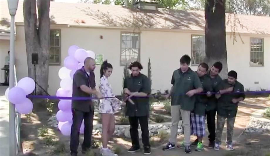 Students from Canoga Park HS and Miller CTC cutting the ribbon