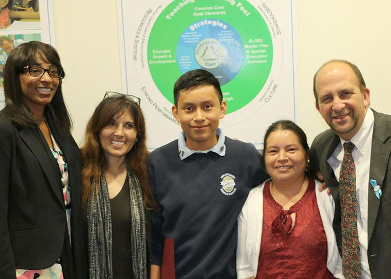 Keven and his mother posing with Board President Zimmer, Mulholland AP Ms. Segal, and 8th Grade Teacher Ms. Sawyers