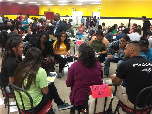 Restorative Justice Circle leading a dialogue about student and family access to health services